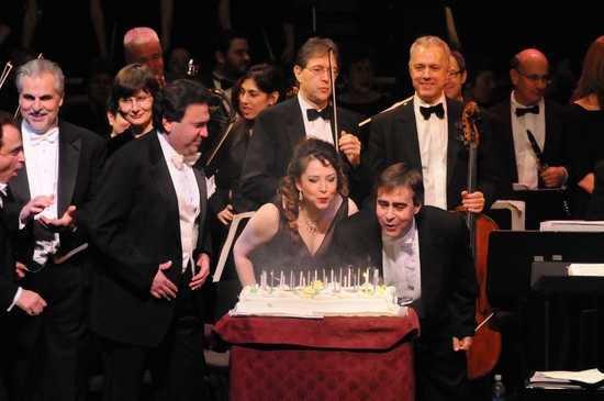 Michael Capasso, Irina Rindzuner and Victor DeRenzi blow out the candles on the cake Photo